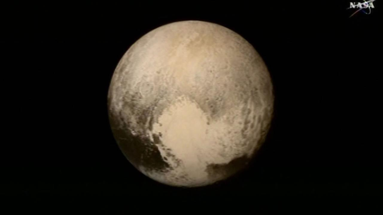 This image of Pluto was sent back to Earth on Tuesday, July 14, 2015 via NASAs New Horizons spacecraft, which has traveled more than 9 years and over three billion miles.