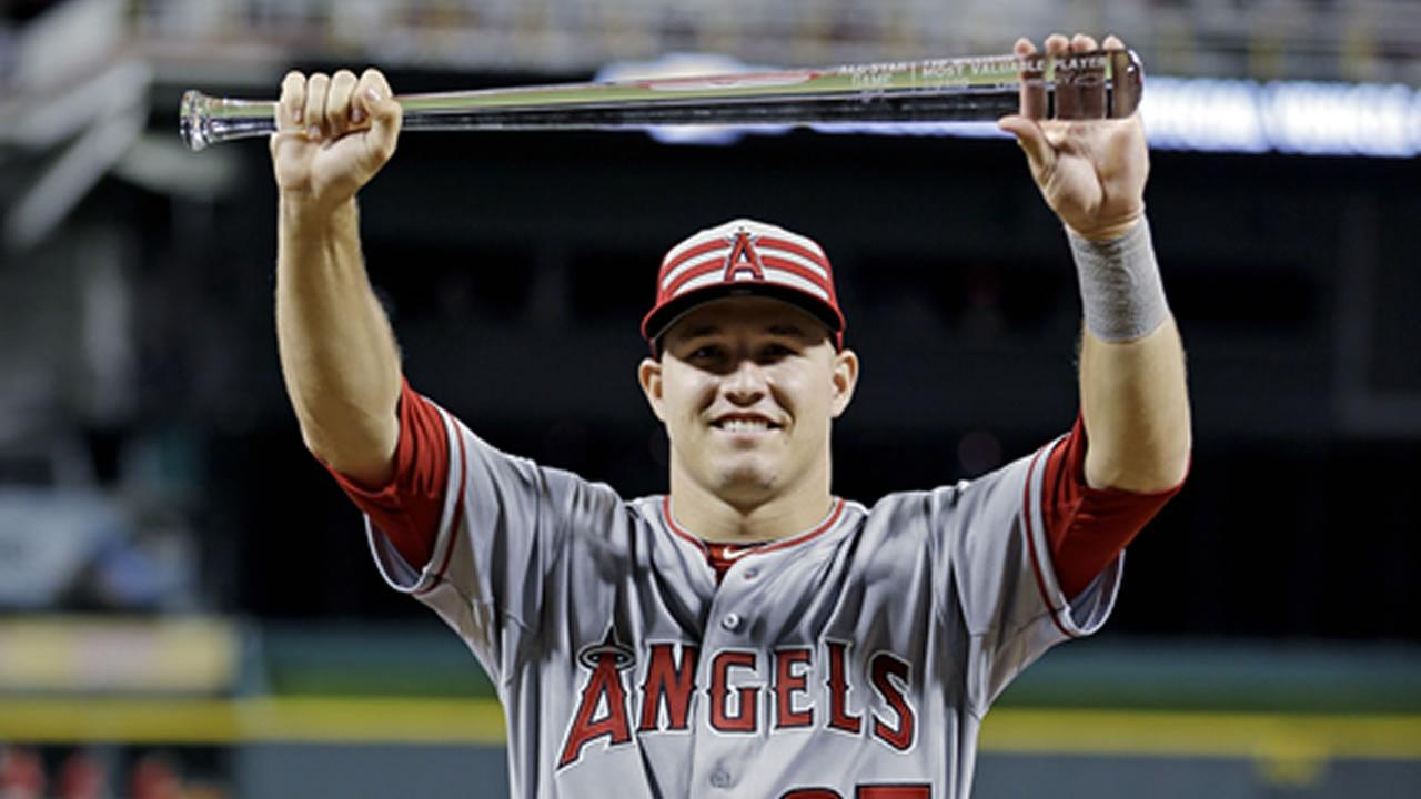 American Leagues Mike Trout, of the Los Angeles Angels, holds the MVP trophy after the MLB All-Star baseball game, Tuesday, July 14, 2015, in Cincinnati.