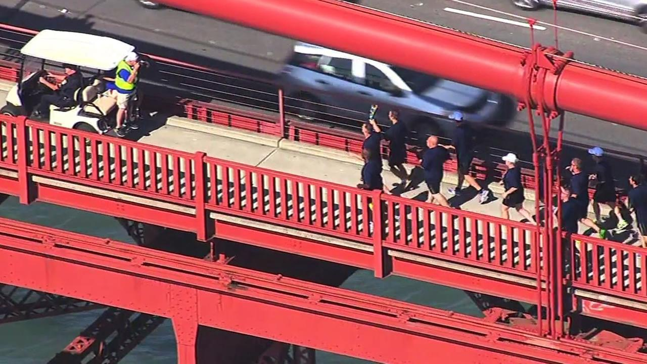 A team of law enforcement officers carried the Special Olympics Light of Hope torch across the Golden Gate Bridge July, 15, 2015.