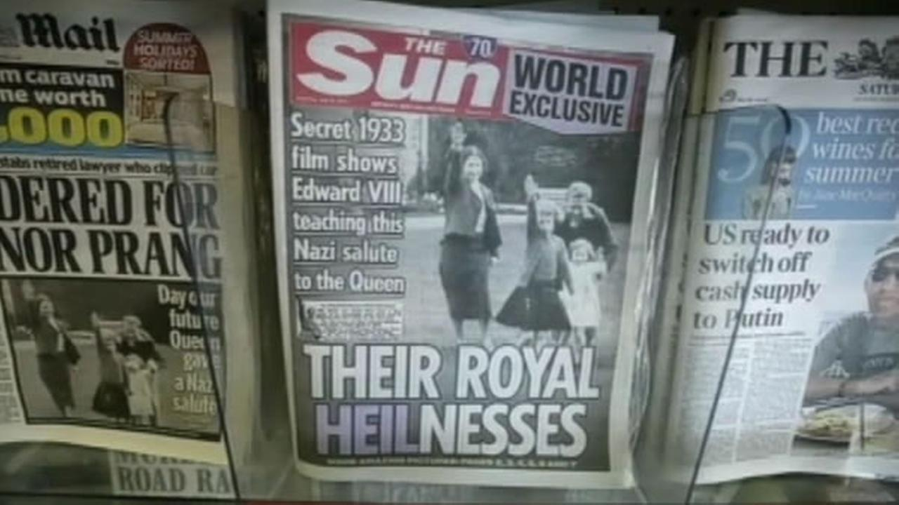 There is outrage from the British Royal Family after The Sun newspaper published images of Queen Elizabeth giving what appears to be a Nazi salute.