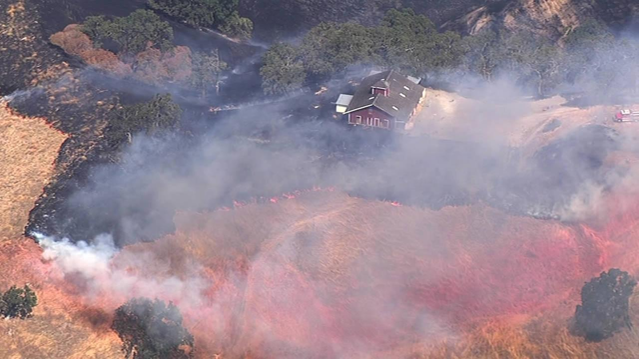 A grass fire burned along I-680 in Sunol on Monday, July 20, 2015