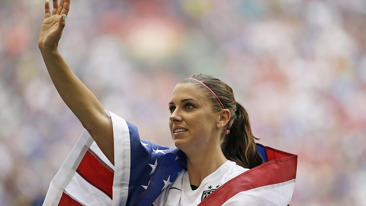 United States Alex Morgan waves to fans after the U.S. beat Japan in the FIFA Womens World Cup soccer championship in Vancouver, British Columbia, Canada, July 5, 2015. (AP Photo/Elaine Thompson)