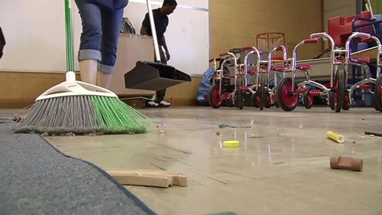 Kids Club employees clean the Antioch school July 22, 2015 after being forced to leave when the school district refused to renew the schools lease.