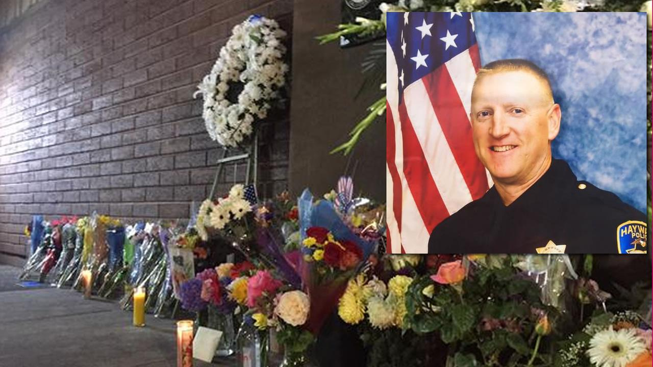 A memorial grows at the Hayward police station for slain police Sergeant Scott Lunger, July 22, 2015.