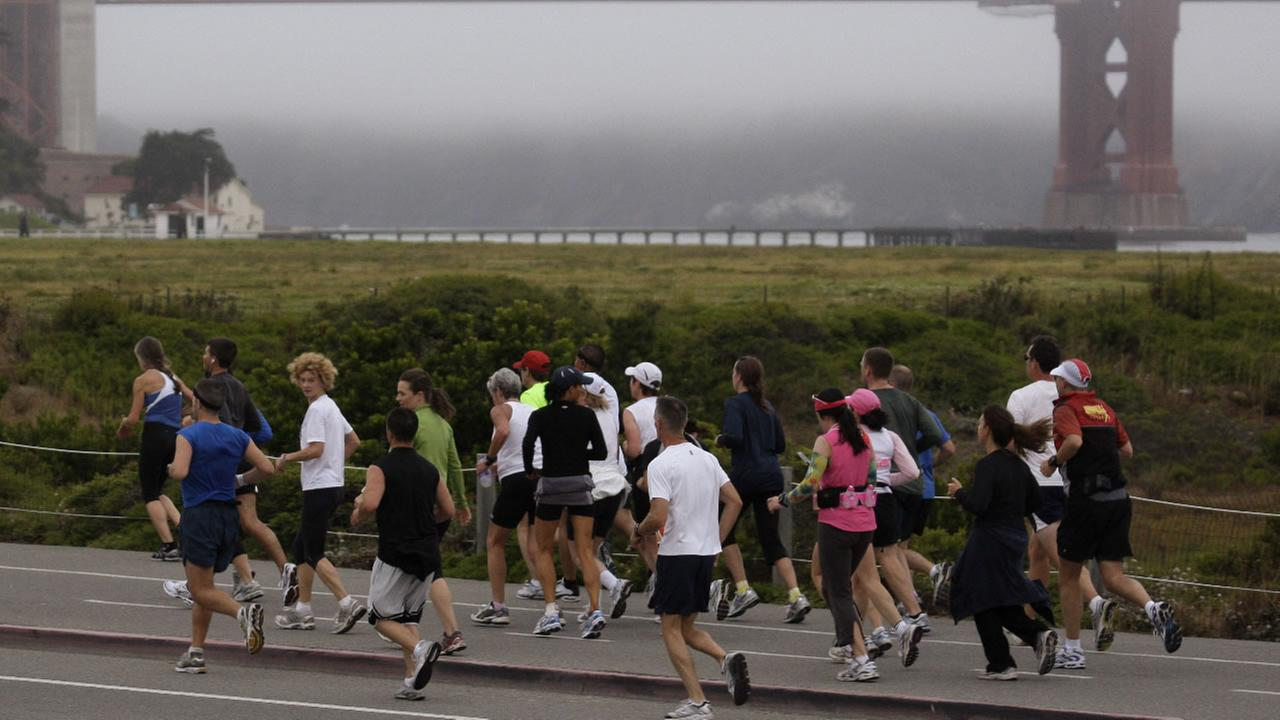 Runners approach the Golden Gate bridge as they participate in the San Francisco marathon Sunday, July 26, 2009, in San Francisco.