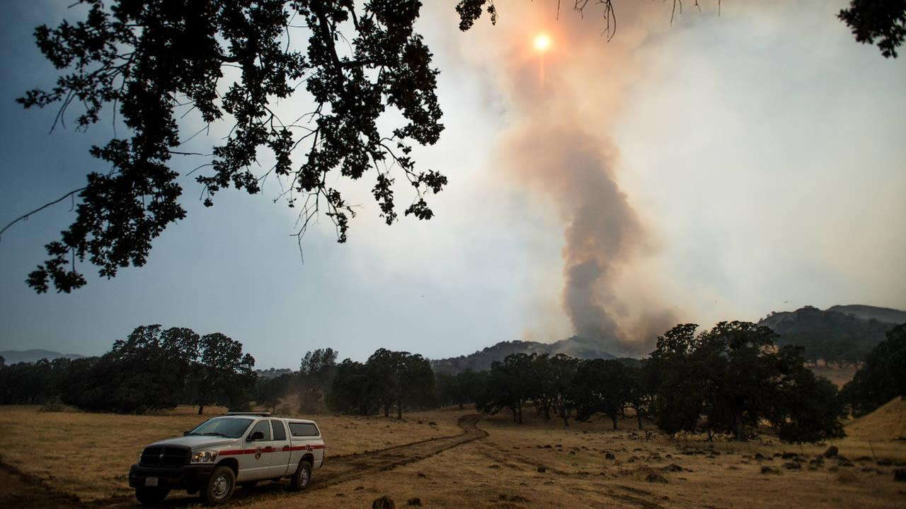 A column of smoke rises from the Wragg fire near Winters, Calif., on Thursday, July 23, 2015. The blaze scorched close to 7,000 acres.