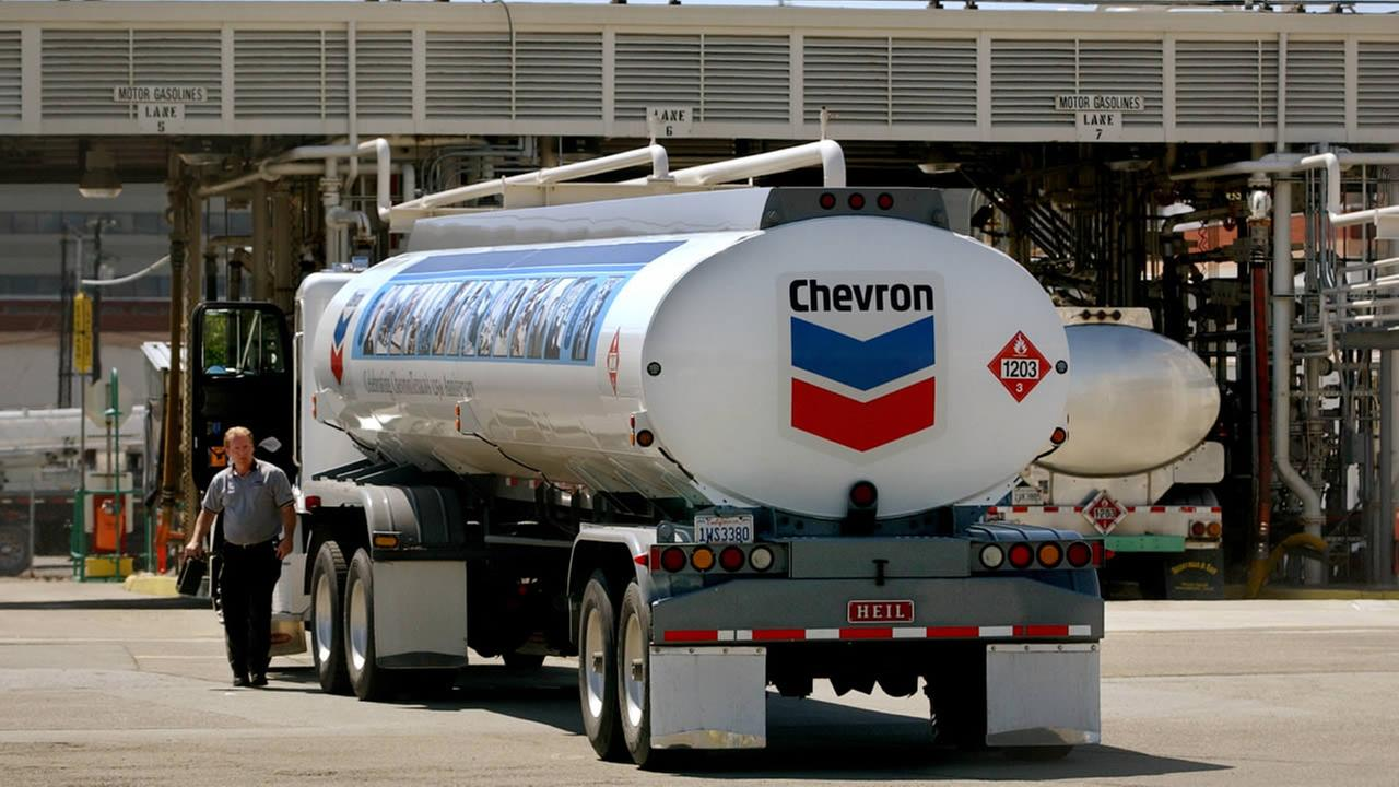 FILE: A Chevron tanker pulls into the Chevron refinery in Richmond, Calif.
