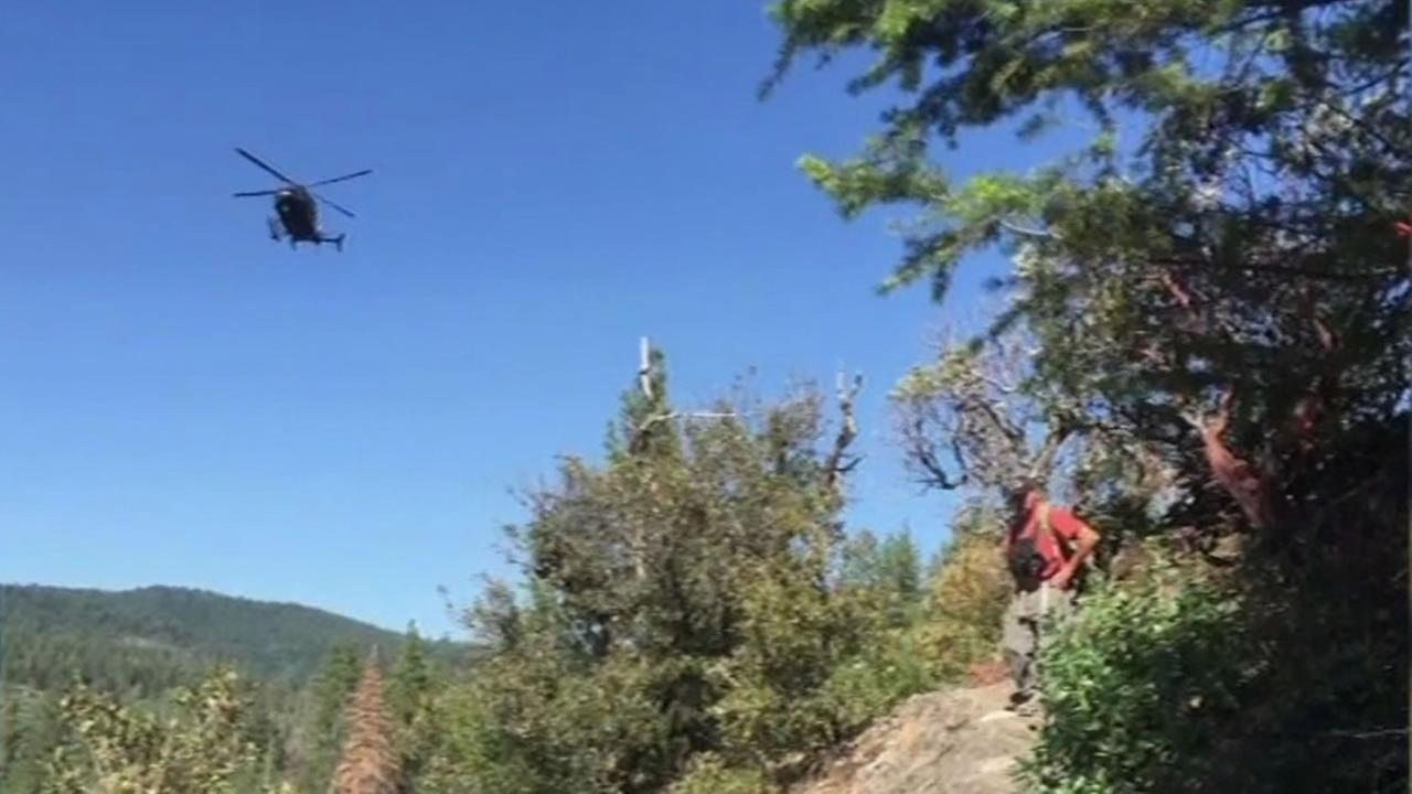 This undated photo shows a National Guard drone flying over the El Dorado National Forest in search of a missing San Francisco teacher.