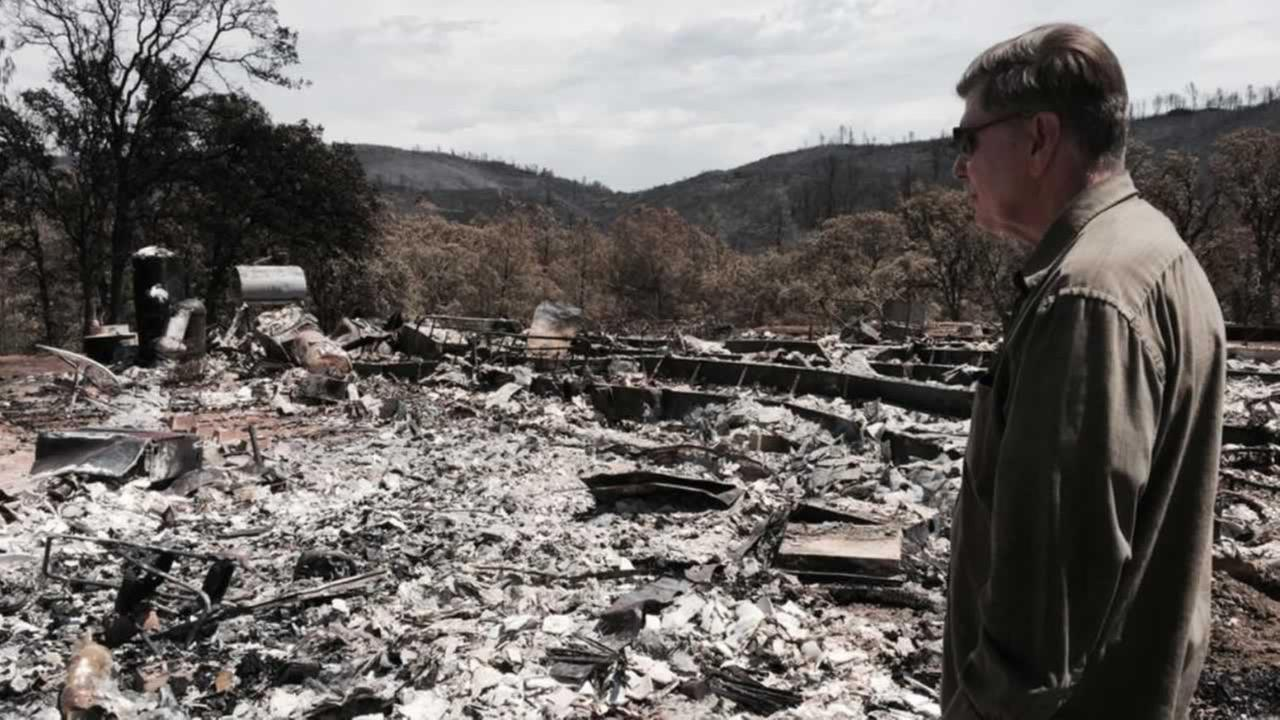 A homeowner surveys whats left of his house after the Rocky Fire thats burning in Lake County, Calif. on Thursday, August 6, 2015.