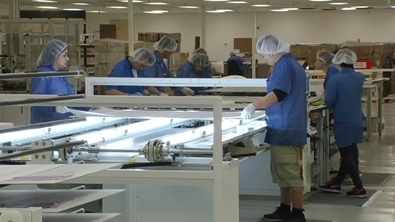 FILE: Employees at work in San Jose, Calif.