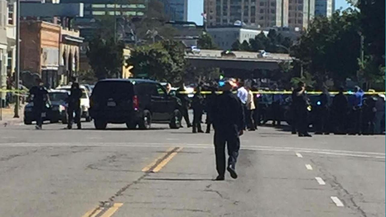 Police investigate an officer-involved shooting involving a robbery suspect at 27th Street and Martin Luther King Way near downtown Oakland, Calif. on Wednesday, August 12, 2015.