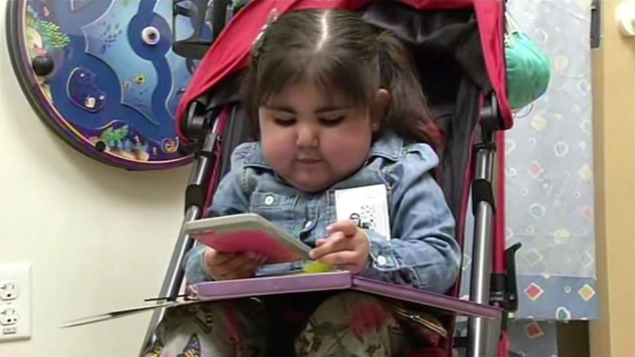 Kate Vargas, 3, plays with her iPad at Lucile Packards Children Hospital August 13, 2015 after recovering from a heart transplant.