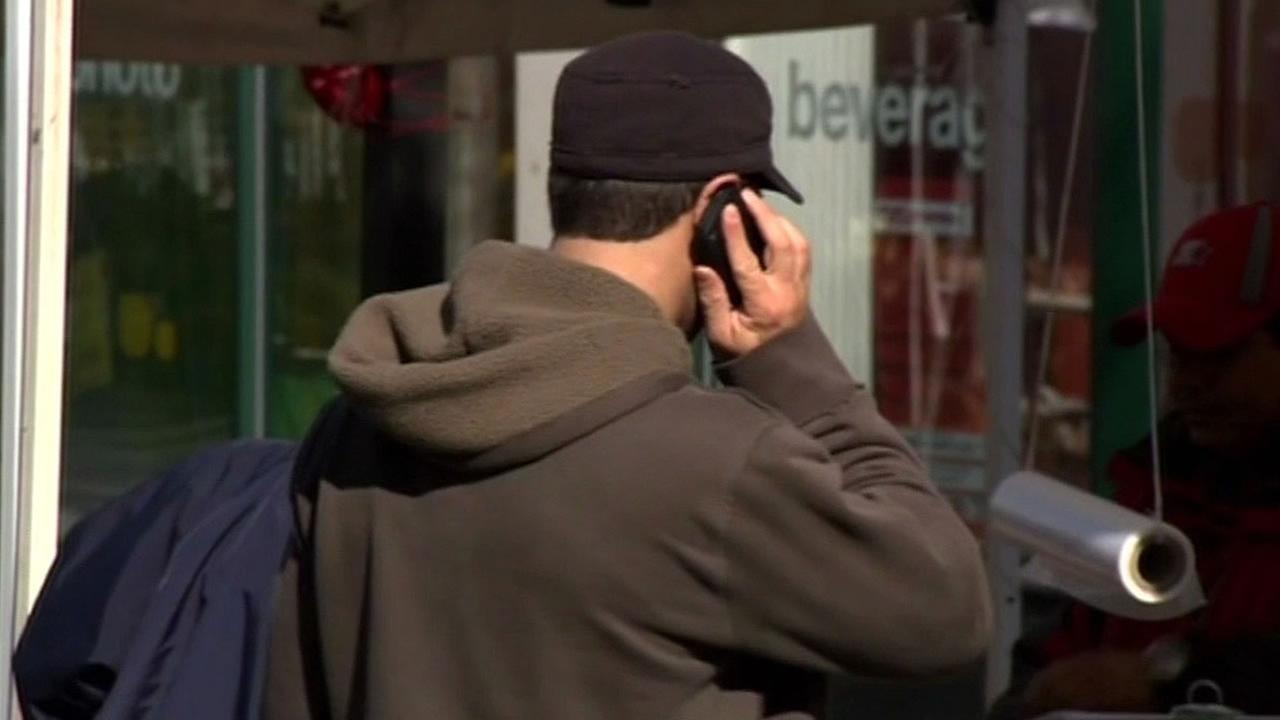 man talking on cellphone with the phone up to his ear