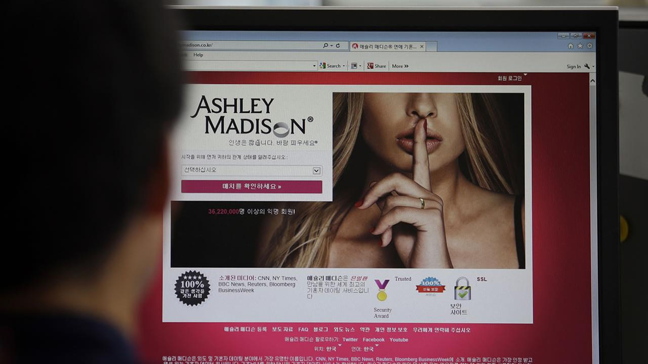 A June 10, 2015 photo from files showing Ashley Madisons Korean web site on a computer screen in Seoul, South Korea.