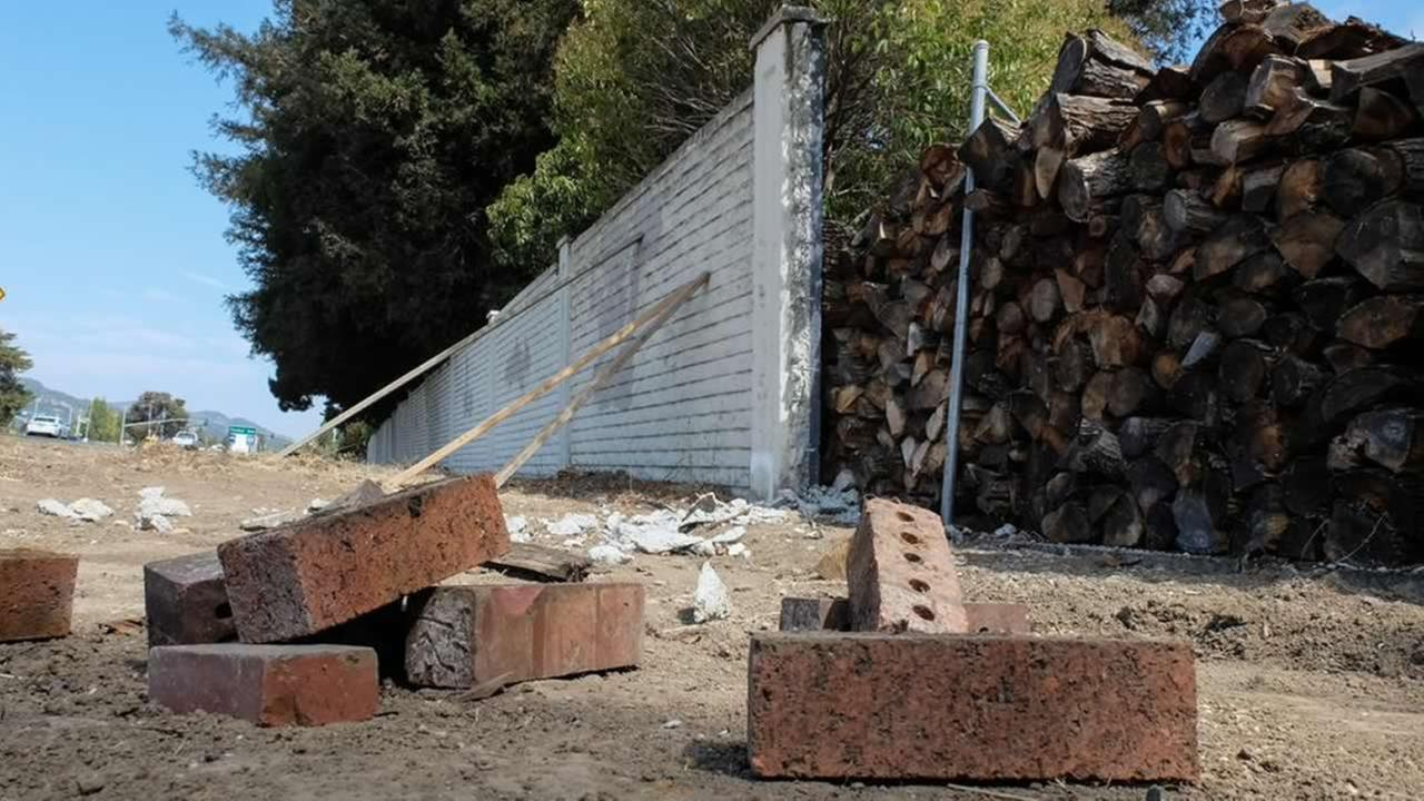 Wall built by developers that crumbled during the quake in Napa, Calif. is still in shambles a year later on August 21, 2015. Residents want money from the city and Caltrans help.