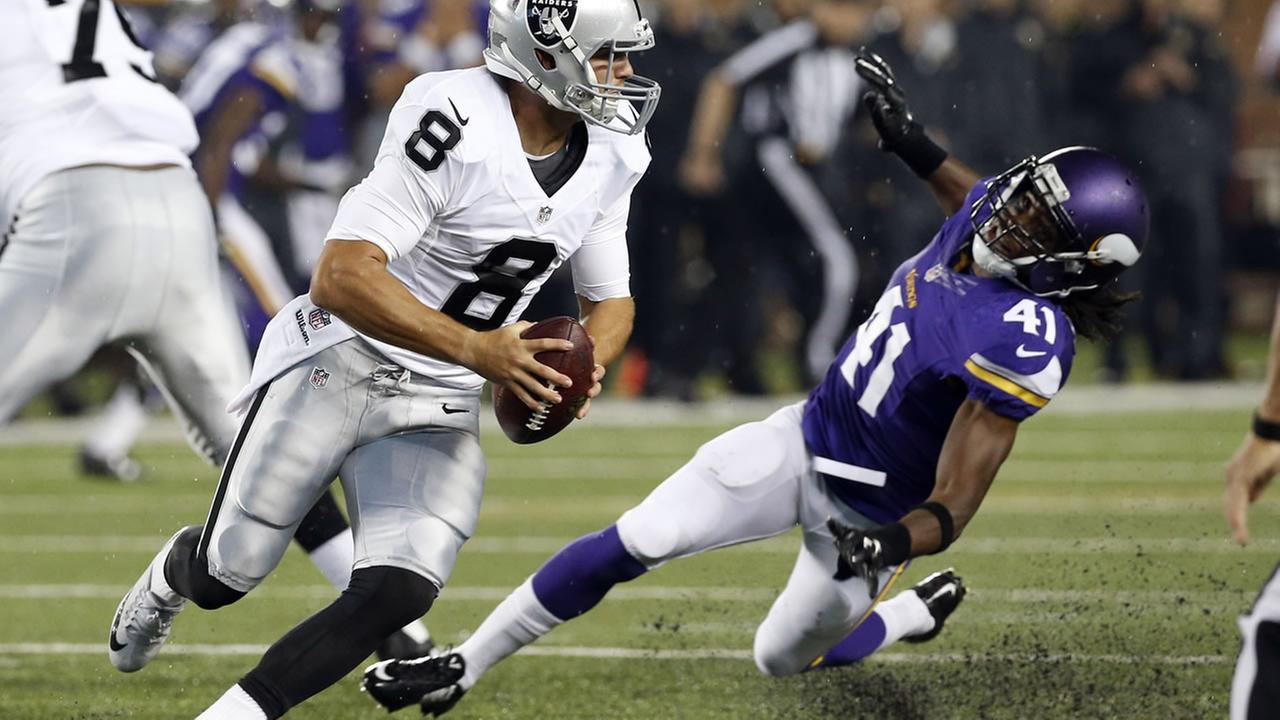 Raiders QB Cody Fajardo (8) scrambles away from Minnesota Vikings strong safety Anthony Harris (41) during a preseason NFL football game, Saturday, August 22, 2015.