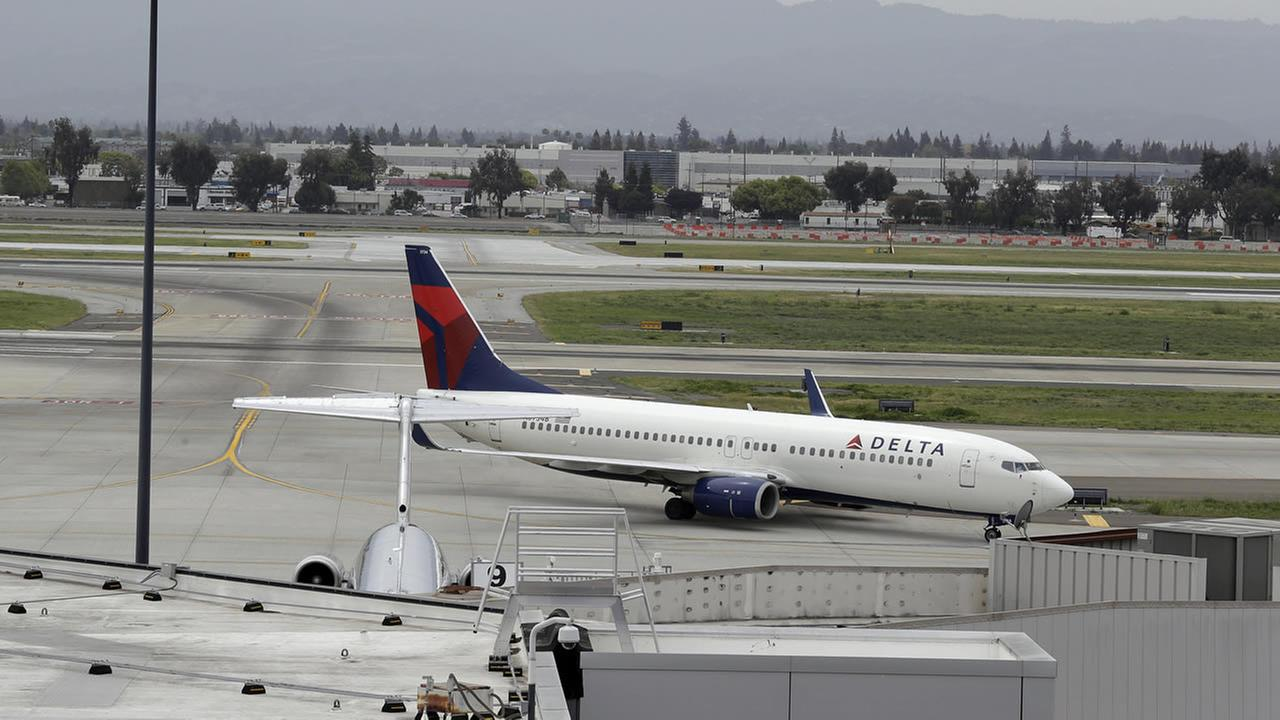 A plane taxis after landing at Mineta San Jose International Airport, Monday, April 21, 2014, in San Jose, Calif. (AP Photo/Eric Risberg)
