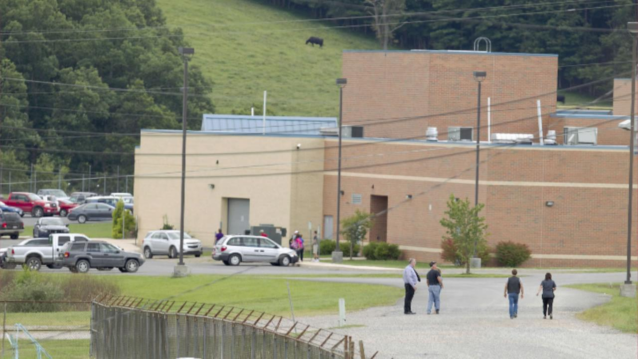 Parents of children from Philip Barbour High School in Philippi, W.v.,walk to the school to meet up with their children that were evacuated after a hostage-like situation.