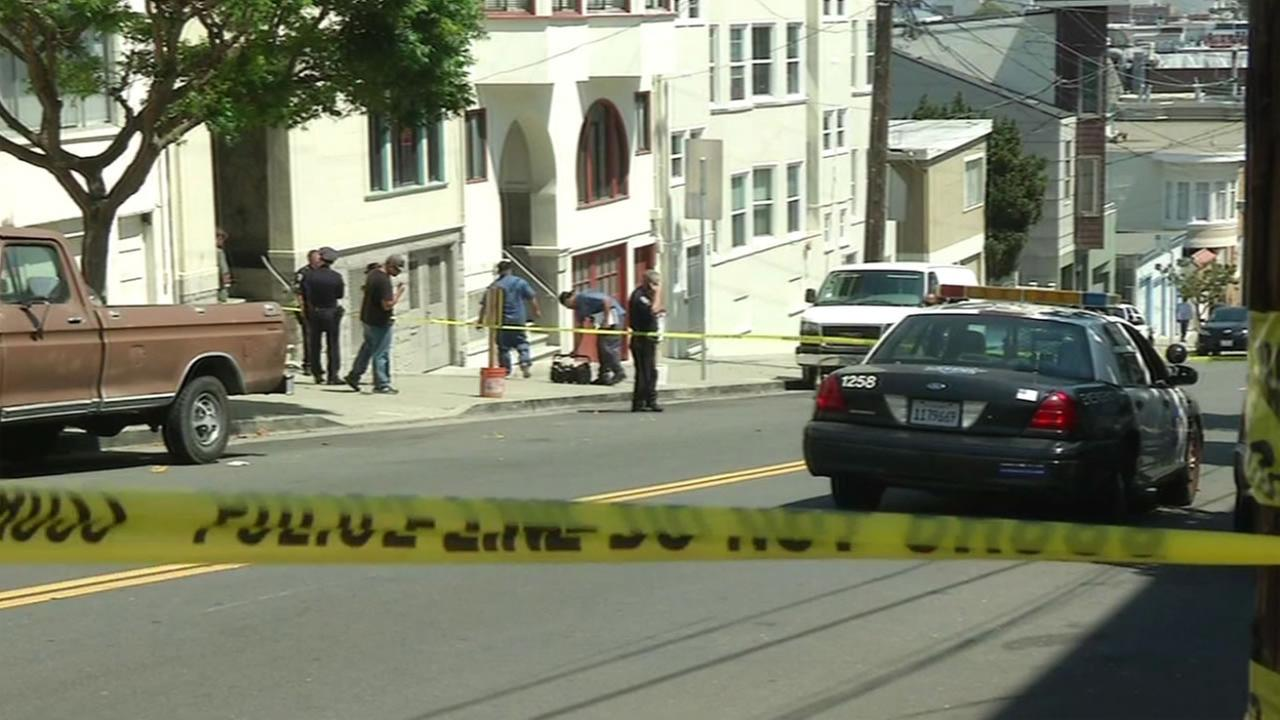 San Francisco police investigate a robbery and shooting that left a tourist injured on Lombard Street in San Francisco, Calif. August, 25, 2015.