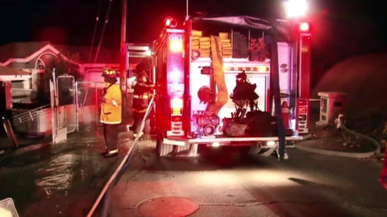Firefighters battle brush fire in Oakland, Thursday, August 27, 2015.