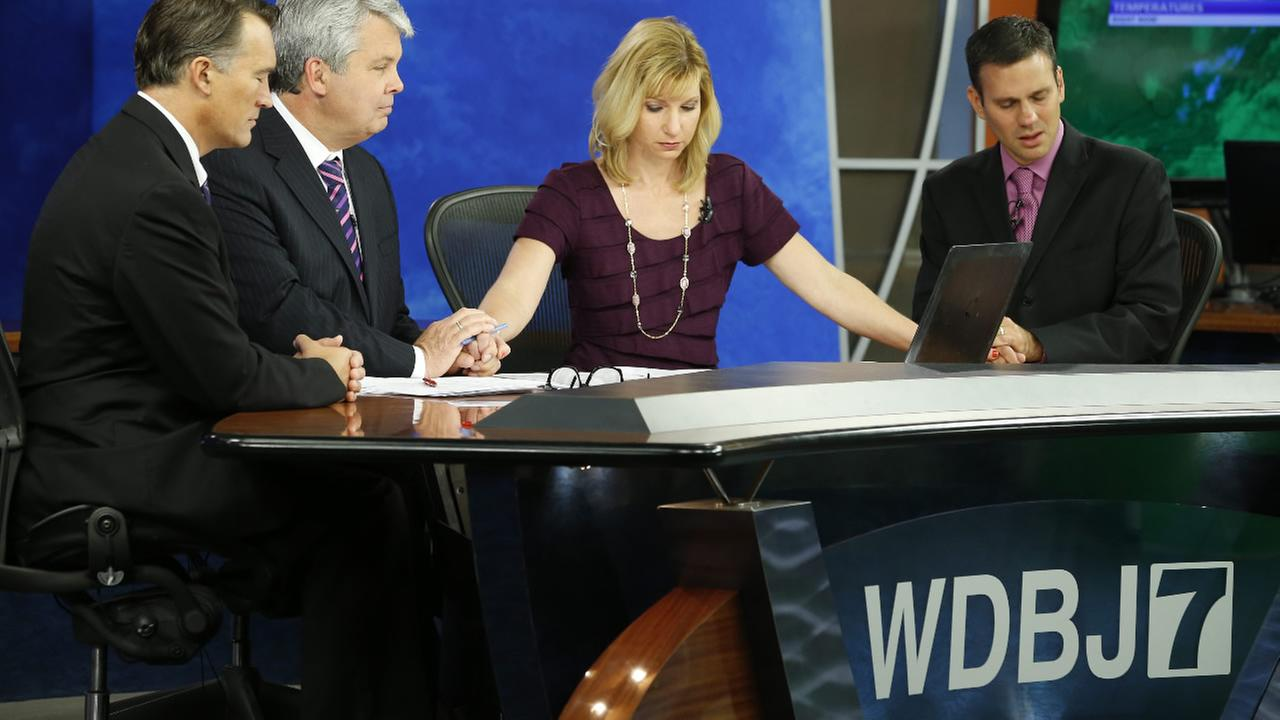 WDBJ-TV7 news morning crew observe a moment of silence during the early morning newscast at the station, in Roanoke, Va., Thursday, Aug. 27, 2015.