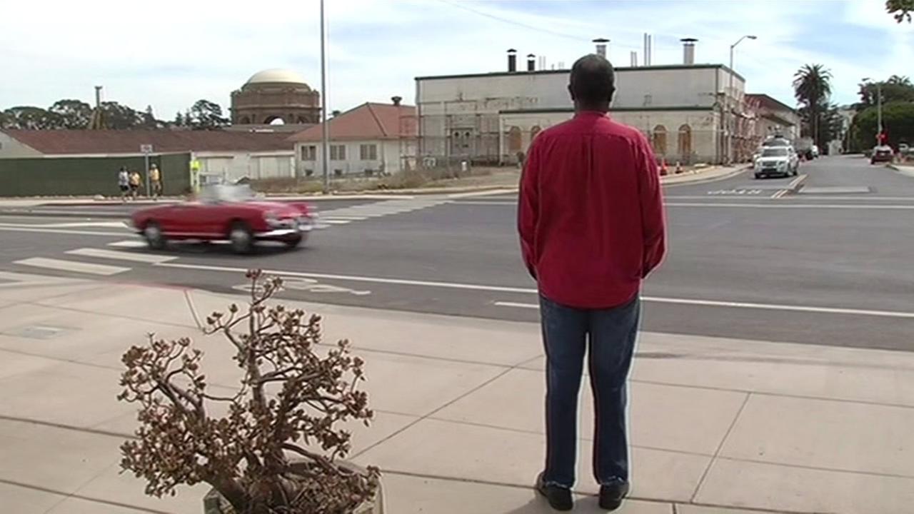 Veteran Robert Webb watches traffic go by near a new crosswalk in San Francisco on Thursday, August 28, 2015.