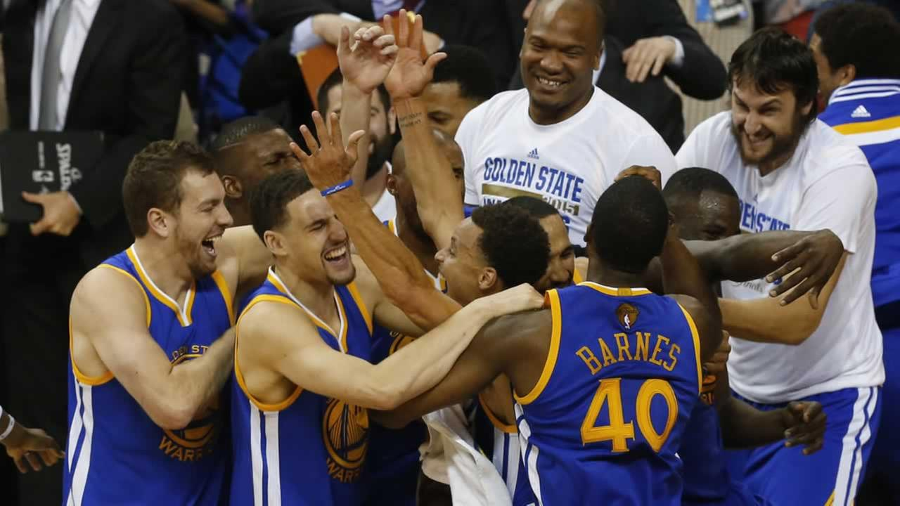 Golden State Warriors players celebrate after Game 6 of basketballs NBA Finals against the Cleveland Cavaliers in Cleveland, Tuesday, June 16, 2015.