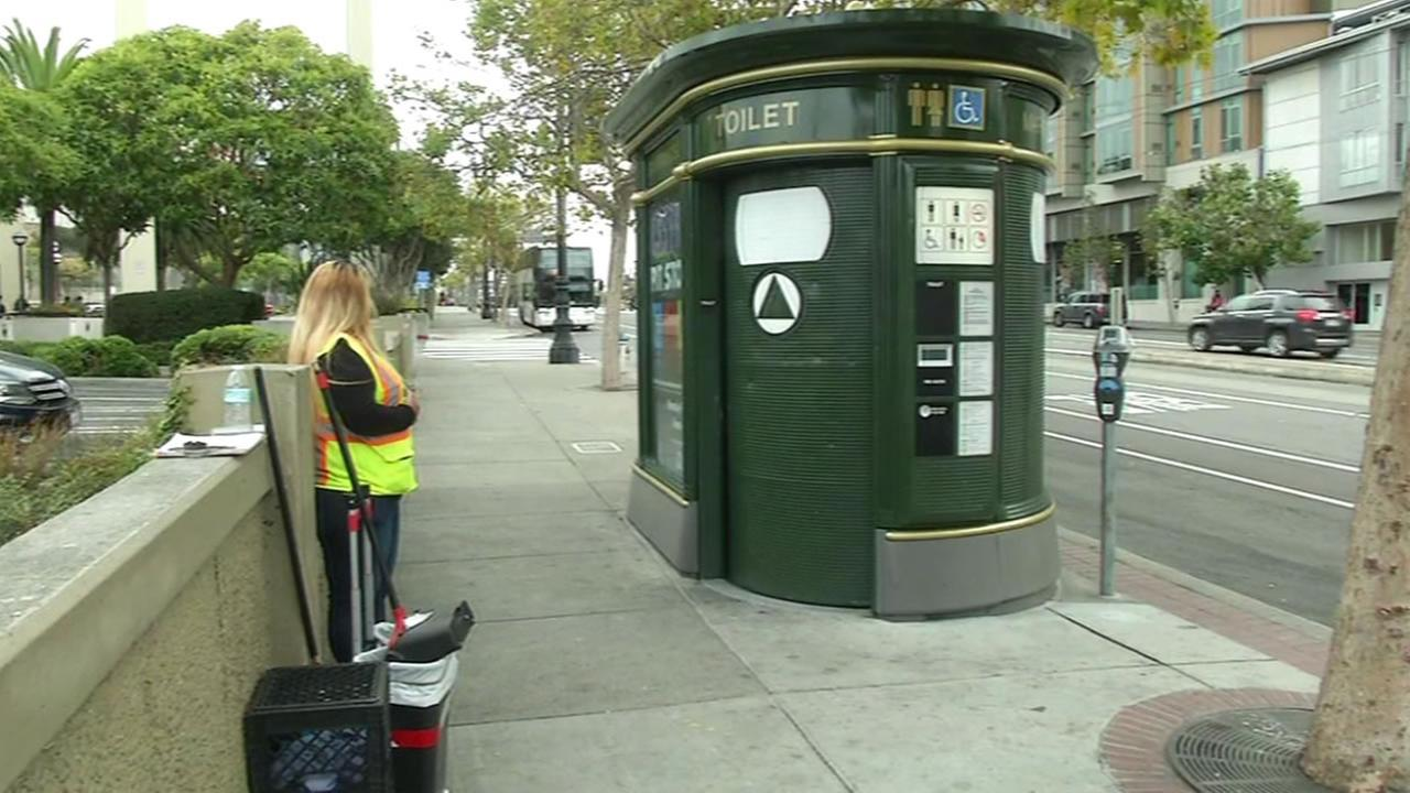 A public works employee monitors the public toilets along San Francisco streets, Sept. 2, 2015.