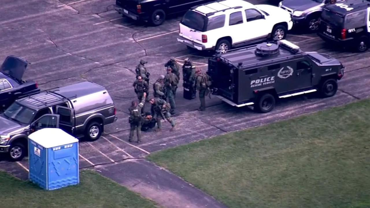 Chicago police  search north suburban Fox Lake for three men after a police officer was fatally shot.