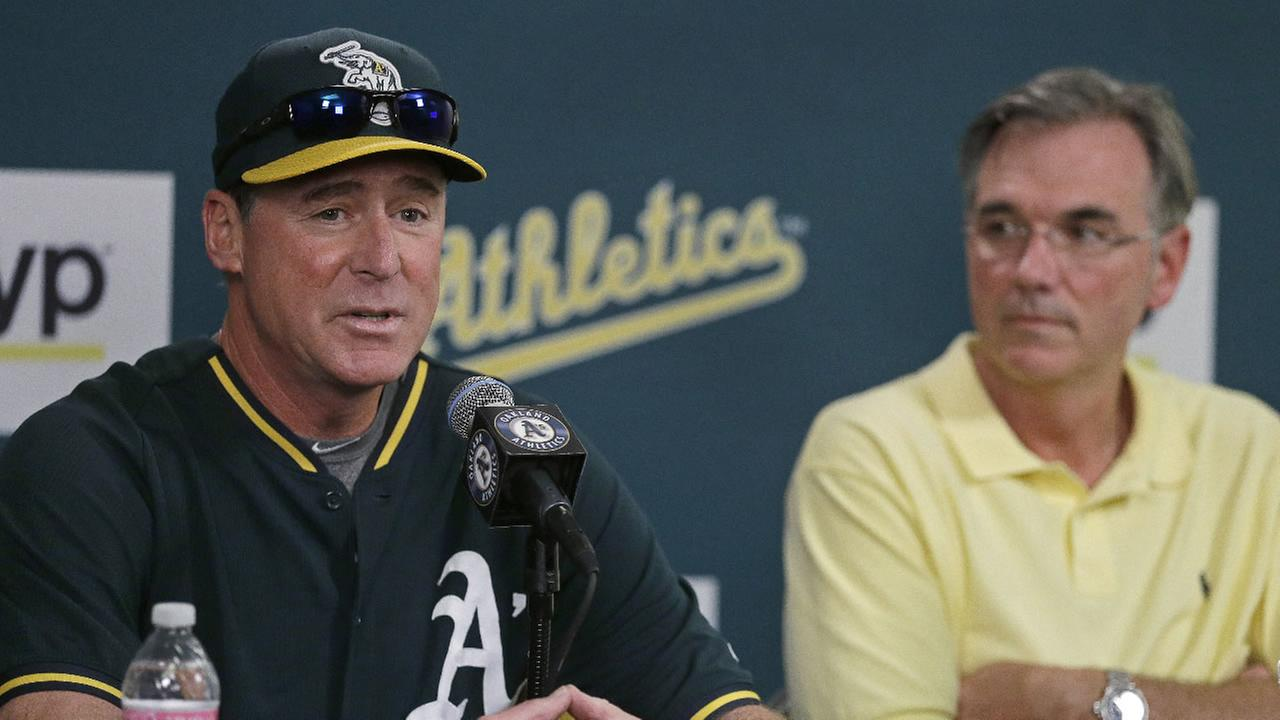Oakland Athletics manager Bob Melvin, left, speaks beside general manager Billy Beane during a media conference Wednesday, Sept. 9, 2015, in Oakland, Calif.