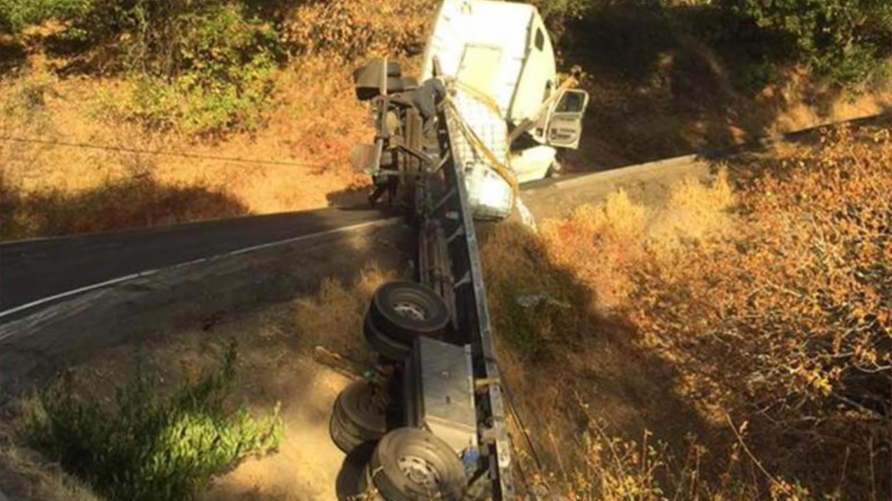 The white big-rig was hanging over a ridge on Lucas Valley Road near Westgate Drive near Novato, Calif., after a crash on Thursday, September 10, 2015.