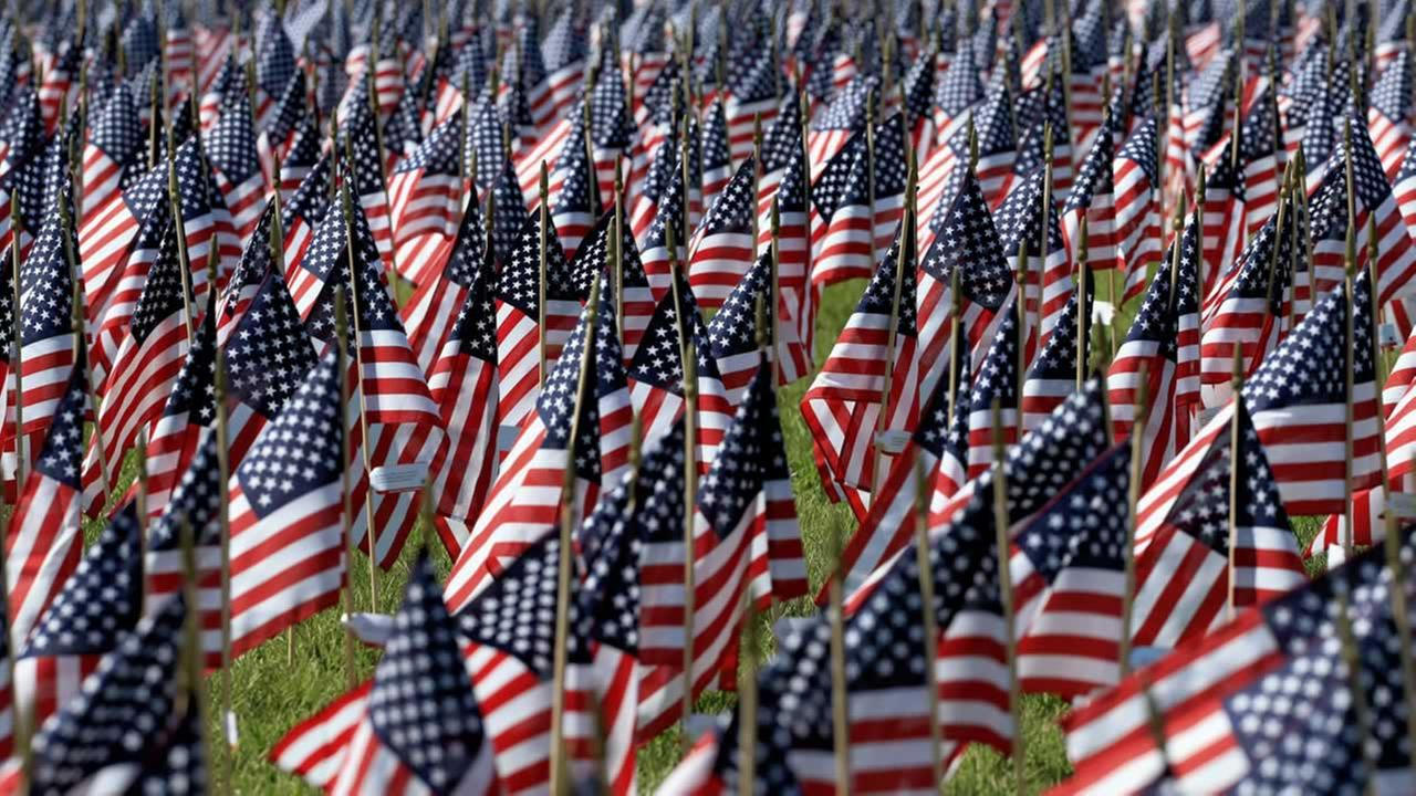 Flags bearing the names of victims of the 9/11 attacks stand in Memorial Park in Omaha, Neb., Thursday, Sept. 10, 2015, one day before the anniversary of the attacks. (AP Photo/Nati Harnik)