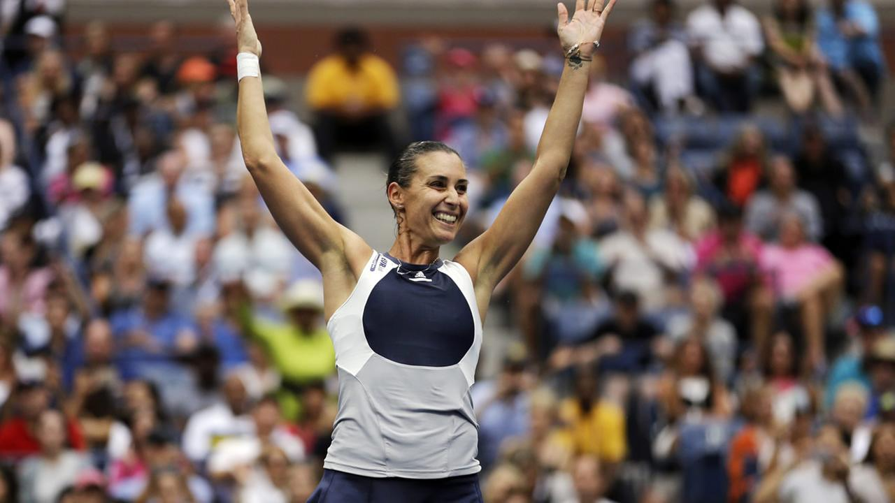 Italys Flavia Pennetta tosses up her racket upon beating Roberta Vinci, of Italy, during the womens championship match of the U.S. Open on Saturday, Sept. 12, 2015, in New York.