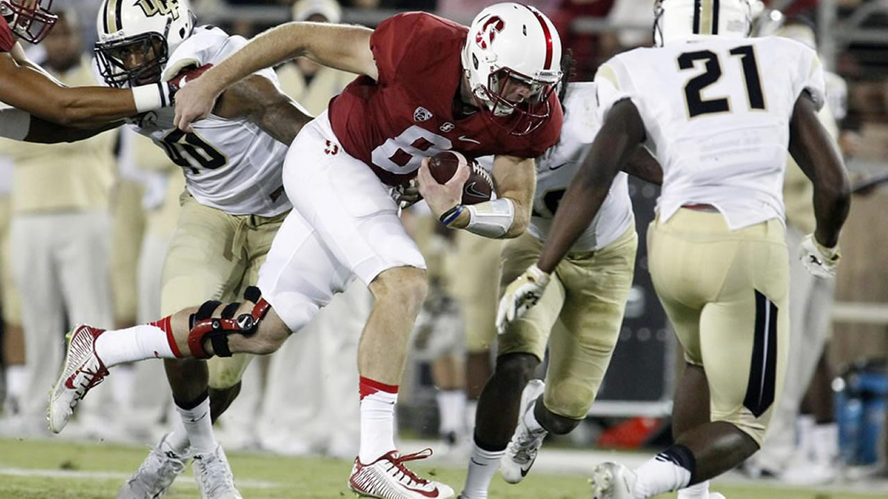 hogan's 3 td passes lead stanford past ucf 31-7 | abc7news