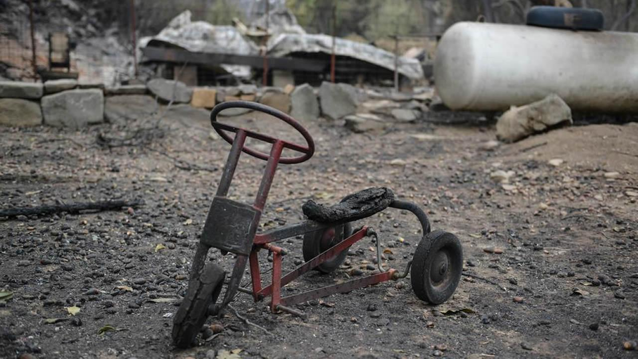 A burned bicycle sits across from Anderson Springs on Highway 175 on Monday, September 14, 2015 after the Valley Fire ripped through the area.