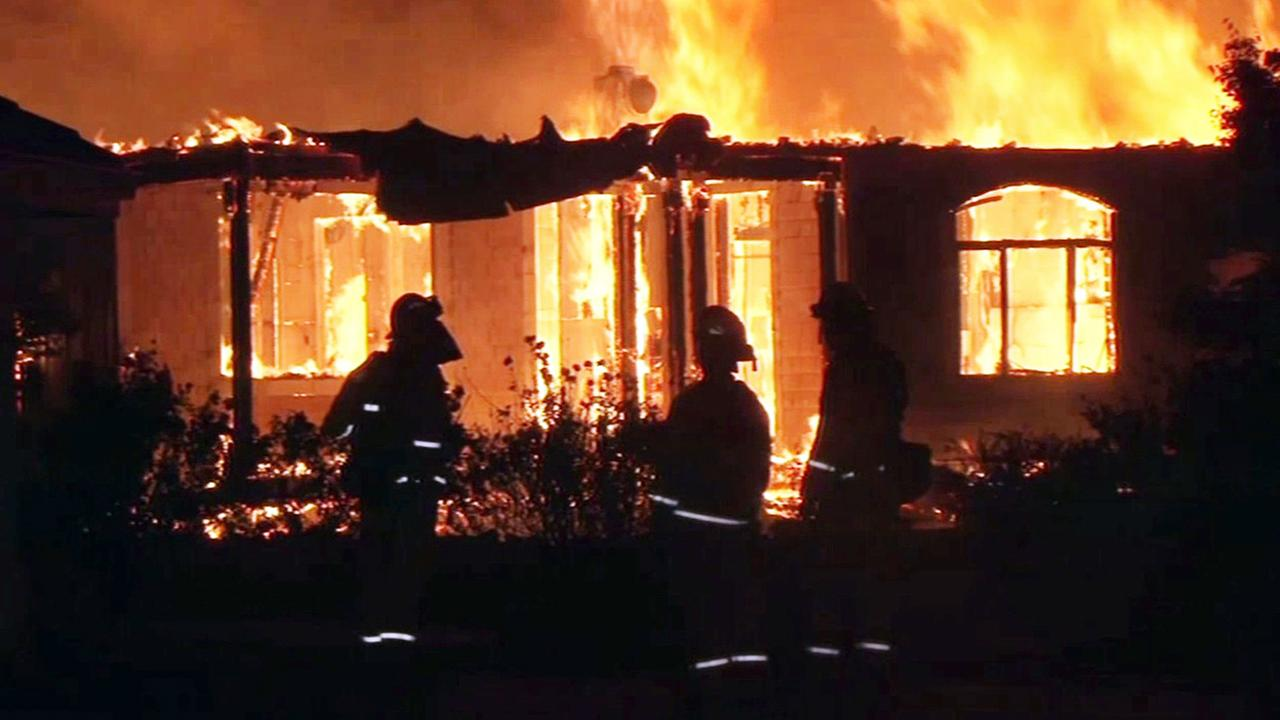 Firefighters at home destroyed by Valley Fire, Monday, September 15, 2015.