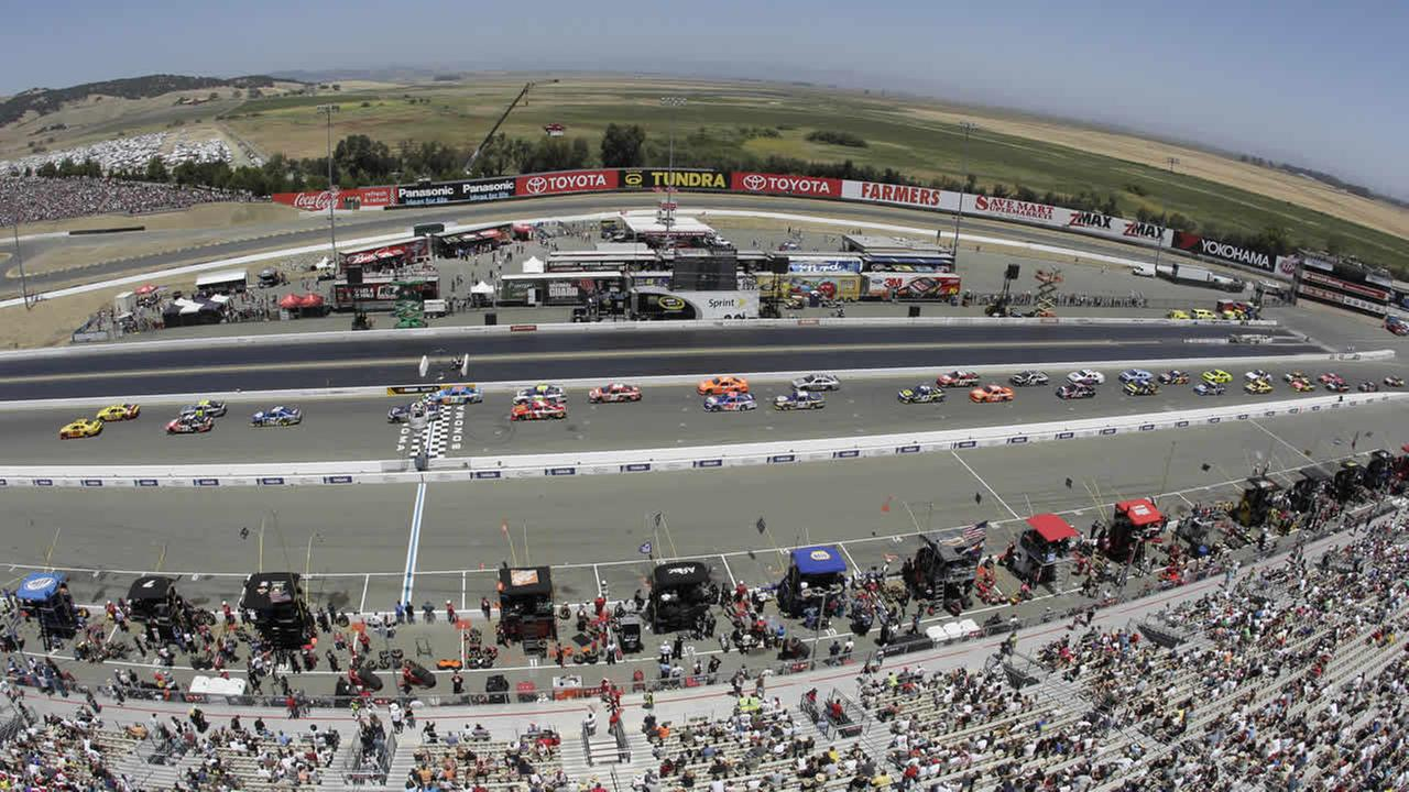 Drivers take the green flag on a restart during the NASCAR Sprint Cup Series auto race Sunday, June 26, 2011, at Infineon Raceway in Sonoma, Calif. (AP Photo/Eric Risberg)