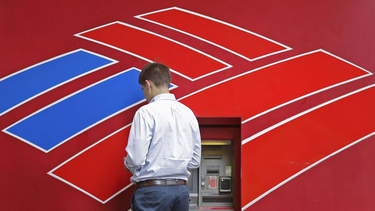 A customer uses a Bank of America ATM near the companys headquarters in Charlotte, N.C., Tuesday, July 7, 2015.