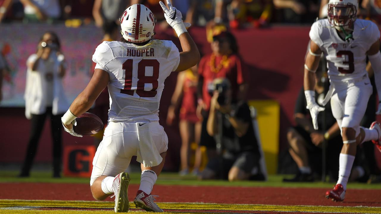 Stanford tight end Austin Hooper celebrates after scoring a touchdown during the first half against Southern California, Saturday, Sept. 19, 2015, in Los Angeles.