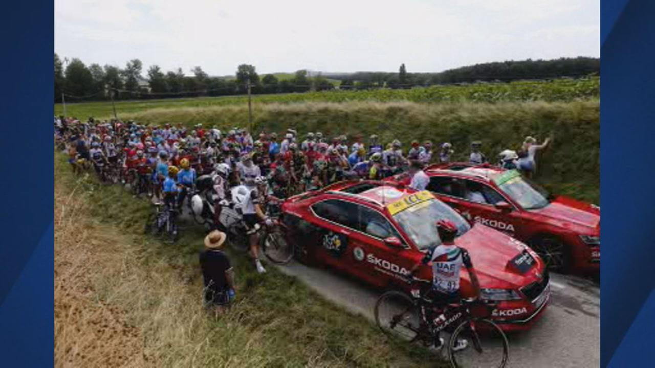 This image shows riders waiting on the road after a farmer protest interrupted 16th stage of the Tour de France in Carcassonne on July 24, 2018.