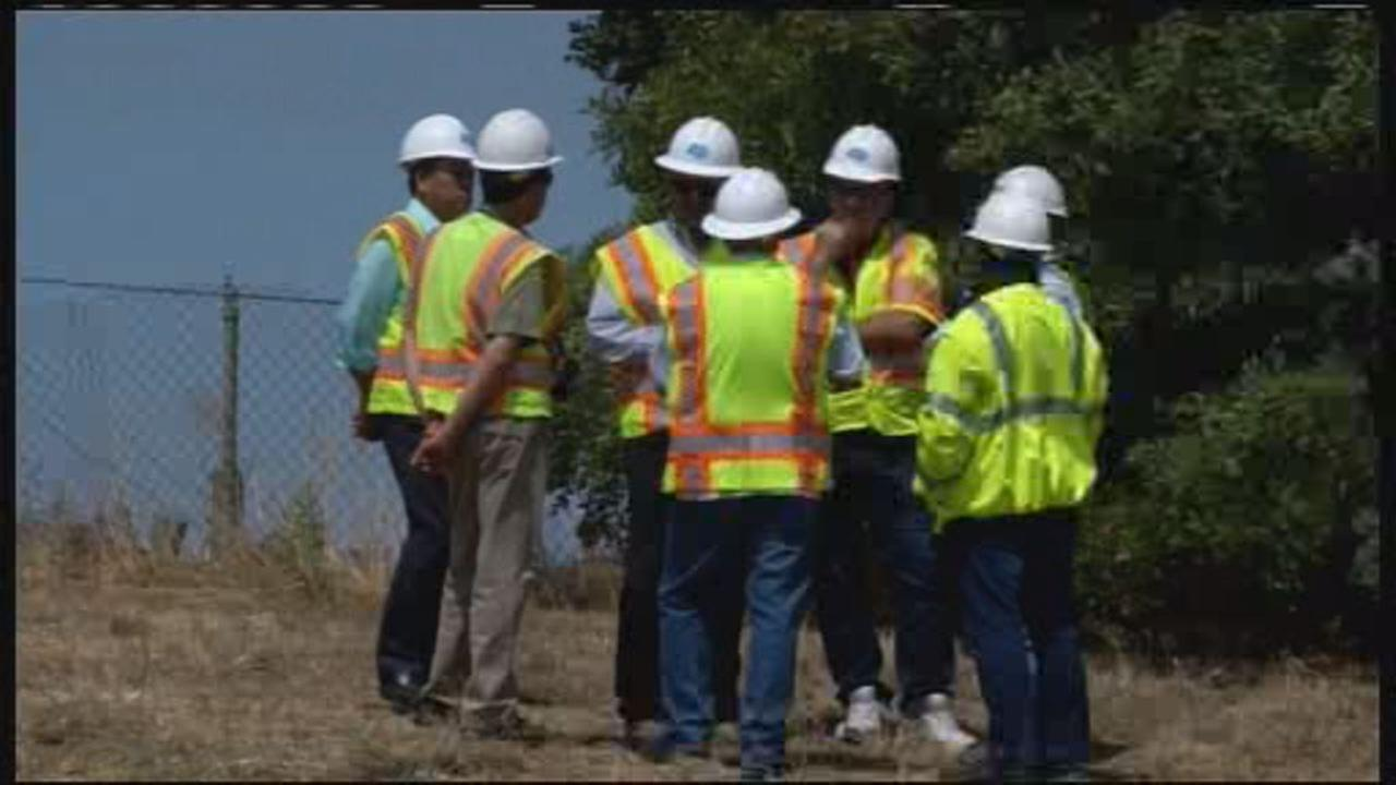 This undated image shows Caltrans workers standing on the side of the road.
