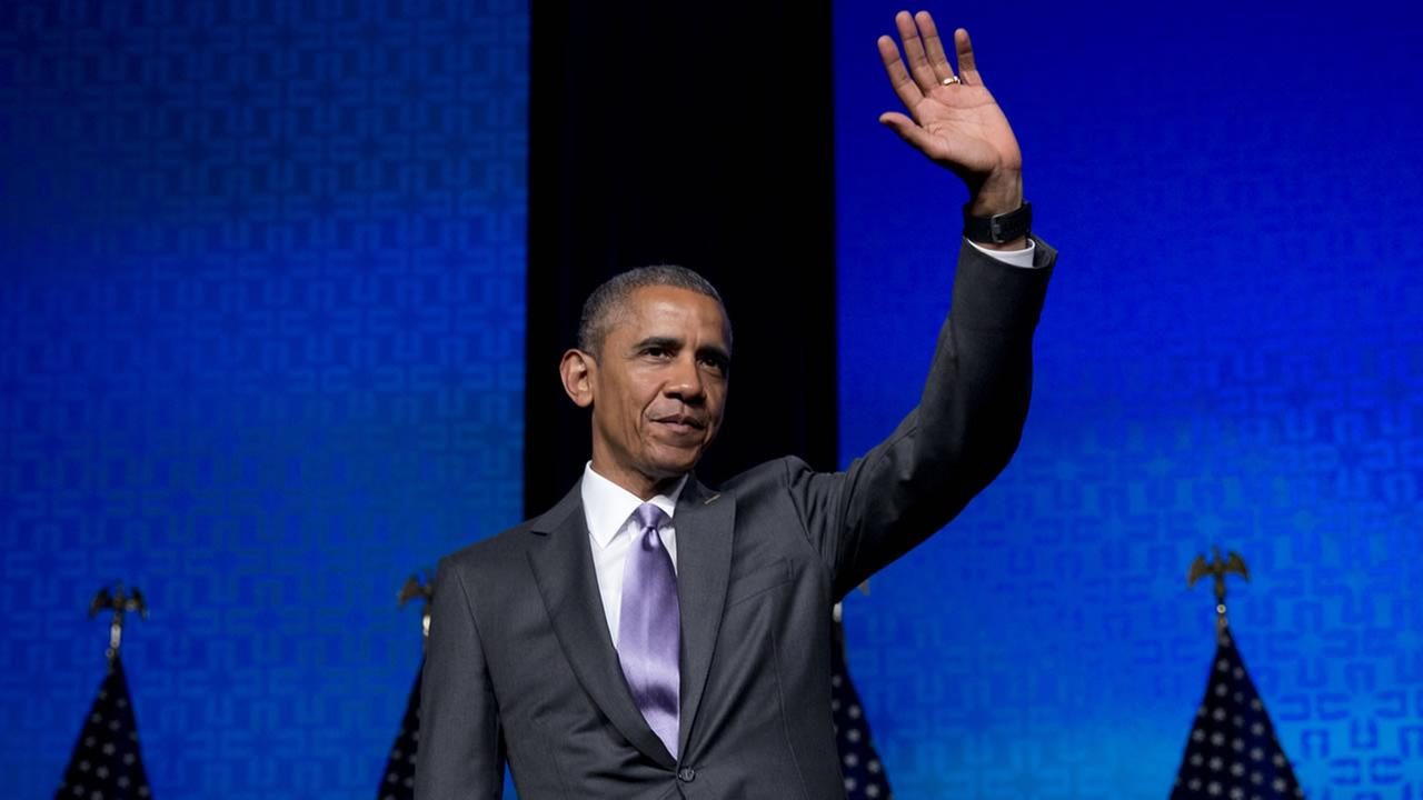 President Barack Obama waves to the audience after speaking to the Catholic Hospital Association Conference at the Washington Marriott Wardman Park in Washington, Tuesday, June 9,