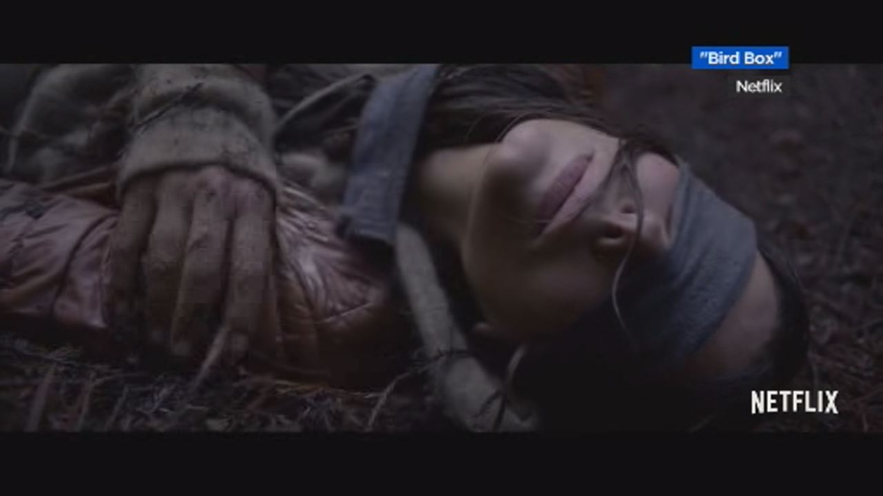 This undated image shows actress Sandra Bullock laying on the ground blindfolded in the Netflix movie Bird Box.