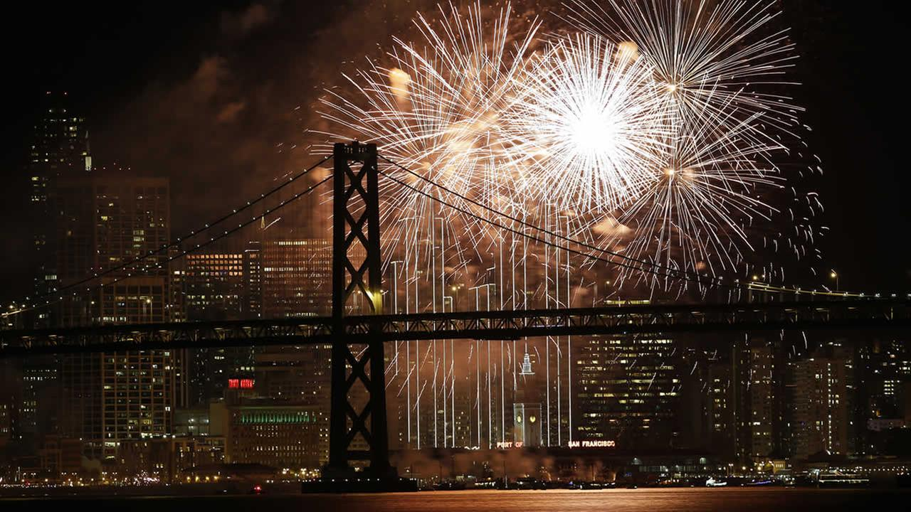 Fireworks light up the sky over the San Francisco-Oakland Bay Bridge and the city skyline as part of New Years Eve celebrations Friday, Jan. 1, 2016, in San Francisco.