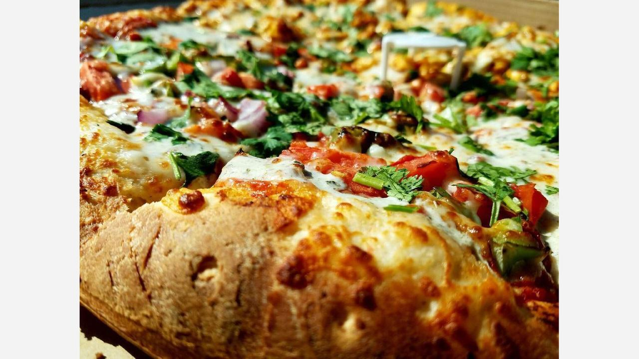 Get Pizza And More At Evergreen North's New 'Tasty Indian Pizza'