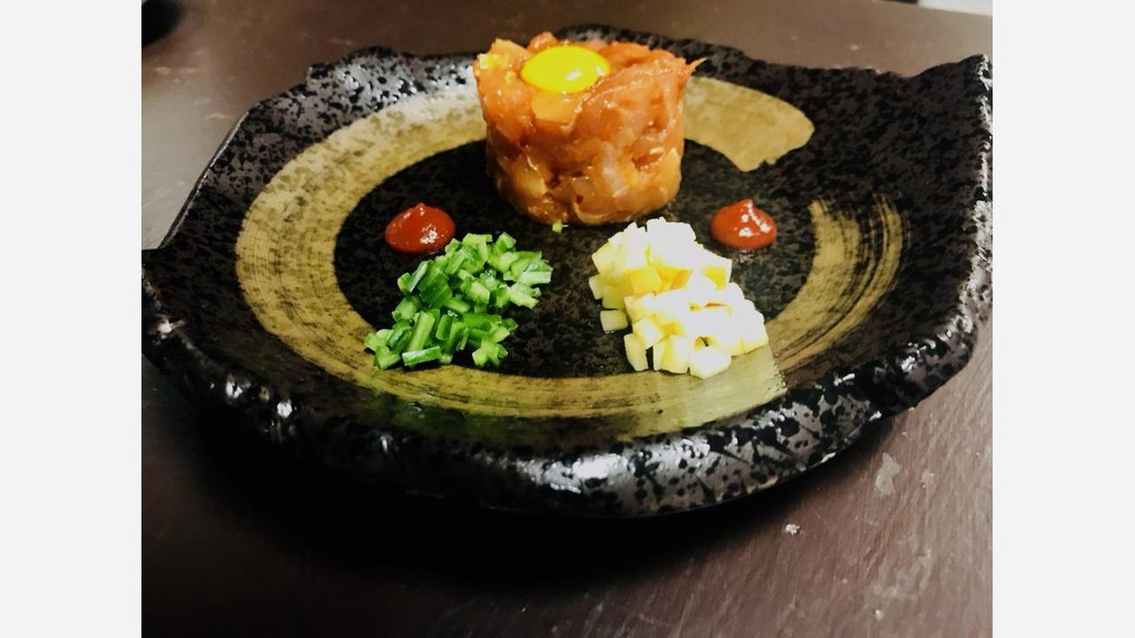 Maguro tartare with quail egg, apple, spicy miso sauce and cucumber. | Photo: Tawara Sake Dining/Yelp