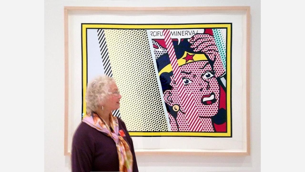 Trina Robbins with Roy Lichtensteins Reflections On Minerva, SFMOMA. | Photo: Trina Robbins/Facebook