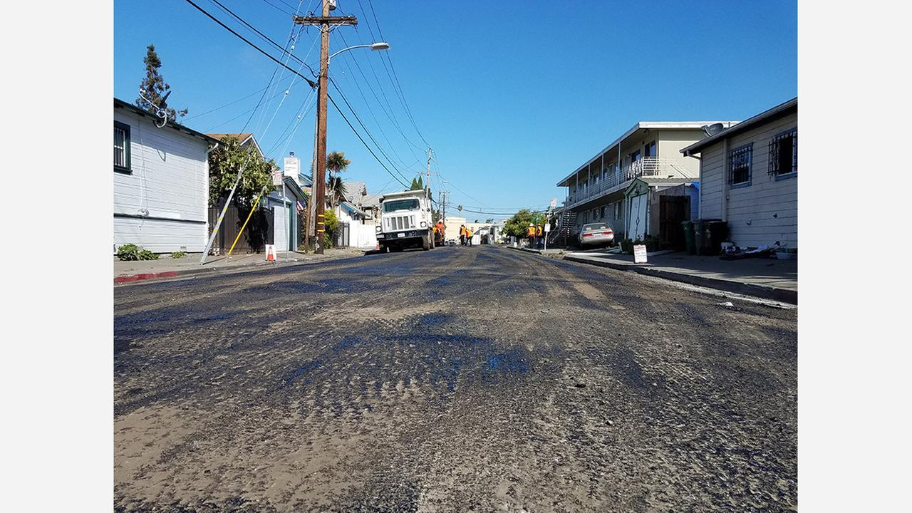East 16th Street being repaved today. Photos: Scott Morris/Hoodline