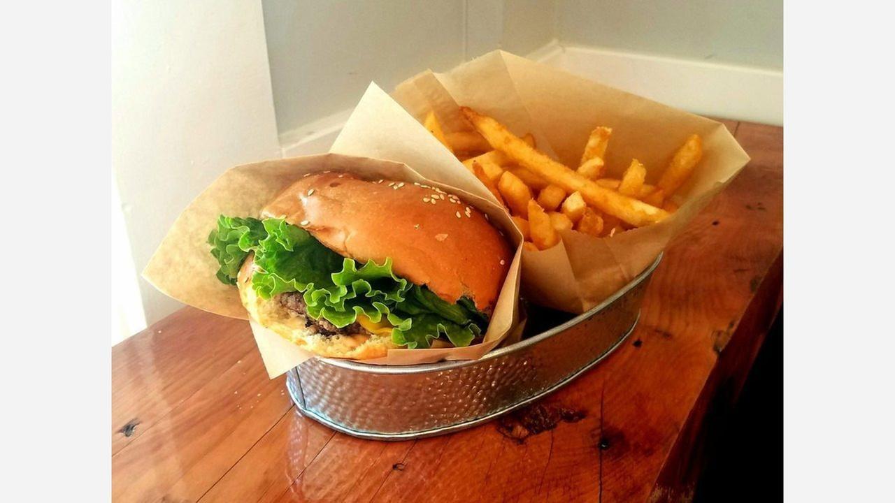 Single patty cheeseburger and fries. | Photo: Ana C./Yelp