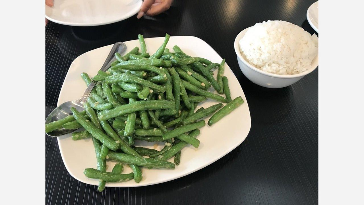 DDC Cafes sauteed garlic green beans. | Photo: Ivonnie S./Yelp